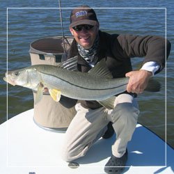 Captain Alex Boehm holds a huge snook