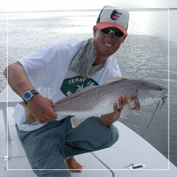 Captain John O'Hearn holds a healthy redfish